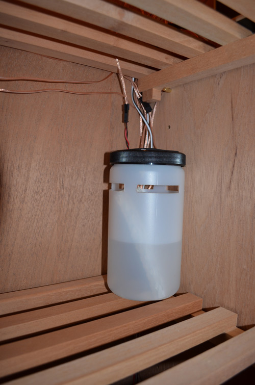 One of the four water canisters.  Holds lots of distilled water! Inside each canister is a replaceable wick. The wicks are mold resistant, and help to draw the humidity closer to the exhaust fan.