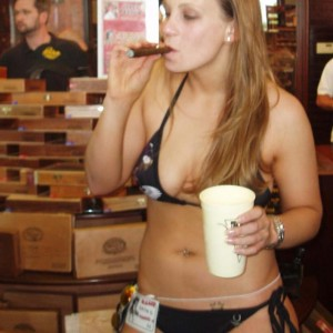 Outlaw Cigar Girl playing with a Cigar