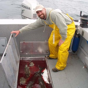 Cory.with.our.Halibut.catch.jpg
